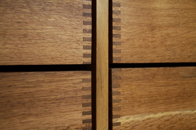 Dove tailed detail on wooden drawers