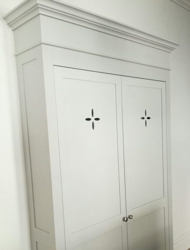 Custom wooden wardrobe with custouts